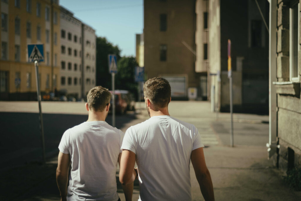 A male couple walking down the road - KMJ divorce lawyers in London