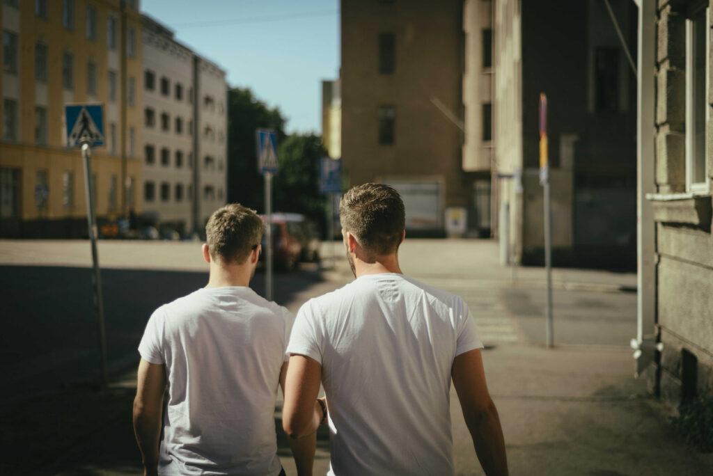 A male couple walking down the road - KMJ divorce lawyers in London