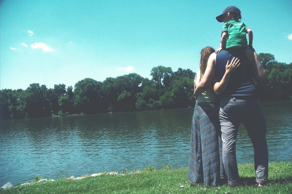 A family looking out to the lake following a meeting with a family lawyer in London