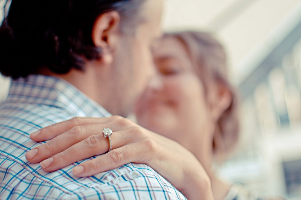 A newly engaged couple who need a prenup from a divorce lawyer in London