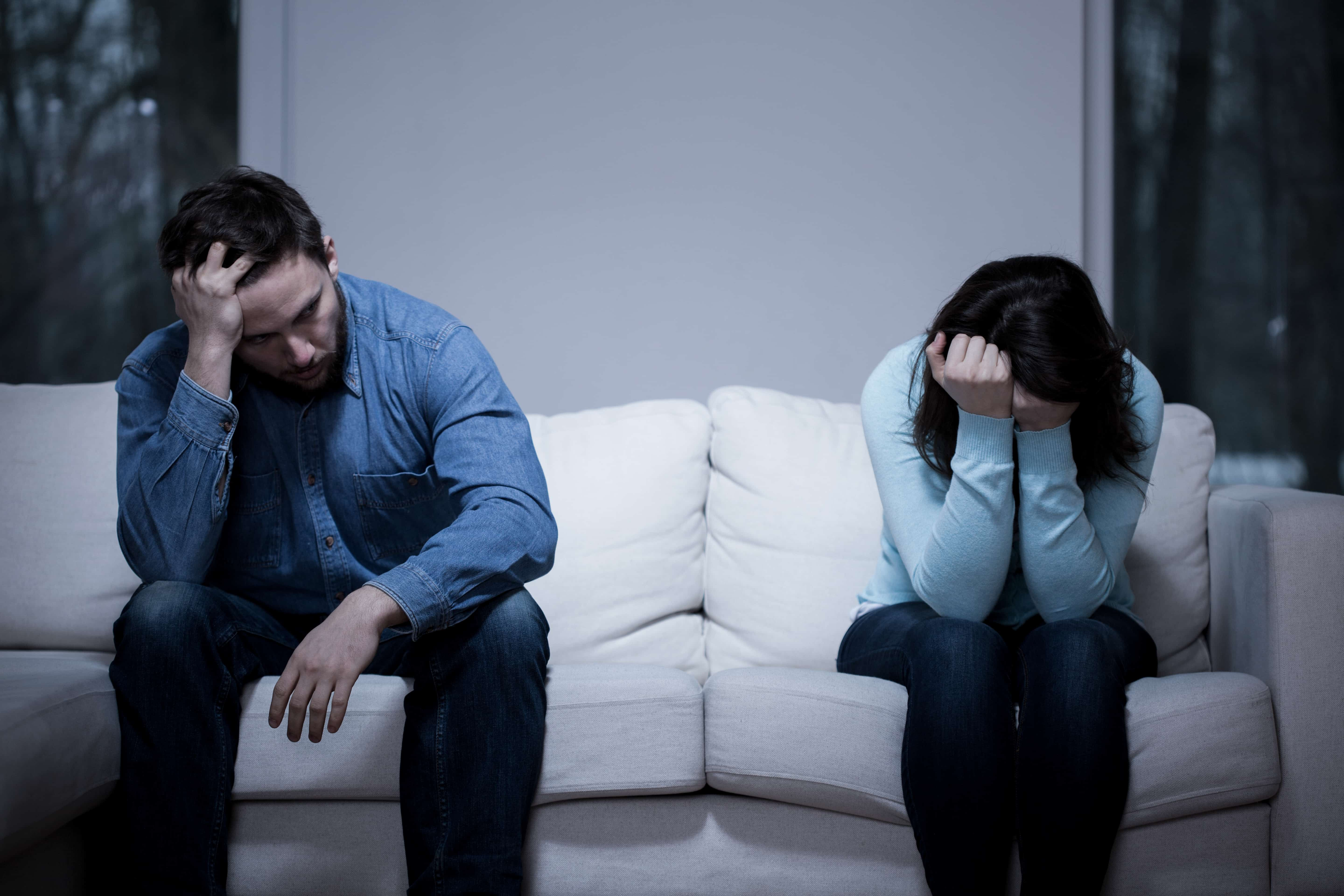 A sad couple who need a legal 500 family law solicitor