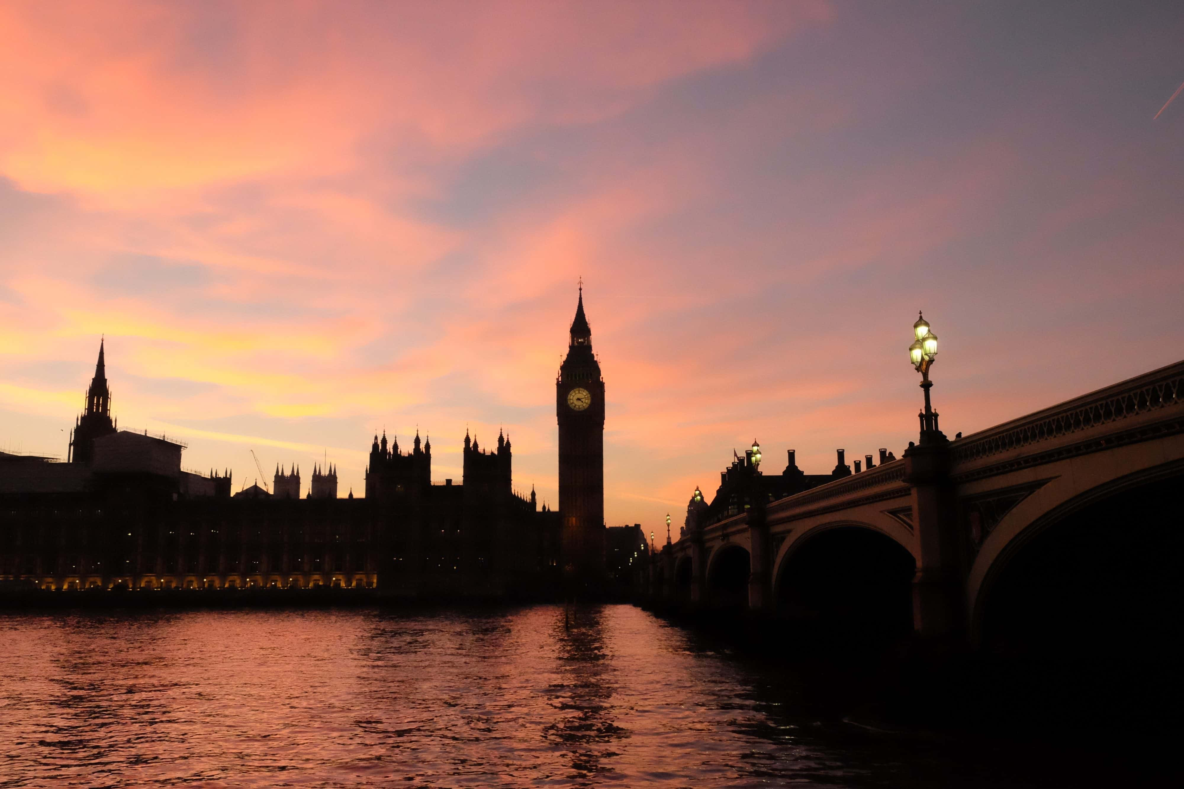London skyline scene at dusk over the Thames with Big Ben in background