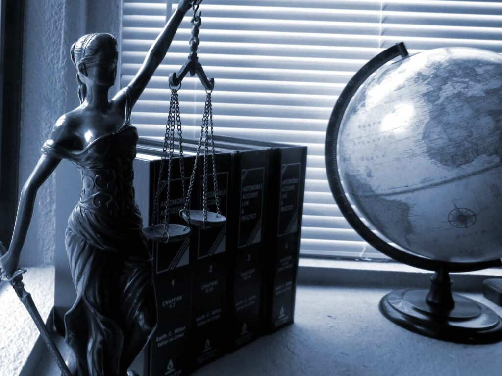 Statue of lady justice and globe -legal 500 family law