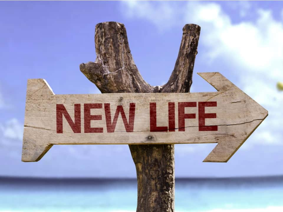 a wooden sign post with the words new life on it, signifying the benefits of clean break orders during a divorce