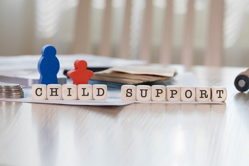 Word Child Support composed of wooden letters, blog post discussing child maintenance options from KMJ family law solicitors in London