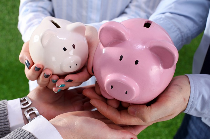 Family hands holding piggy banks - symbolising the law around inheritance and divorce