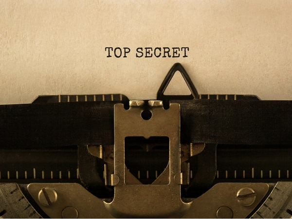 top secret written on a brown file in typewriter text symbolic of planning a divorce secretly.